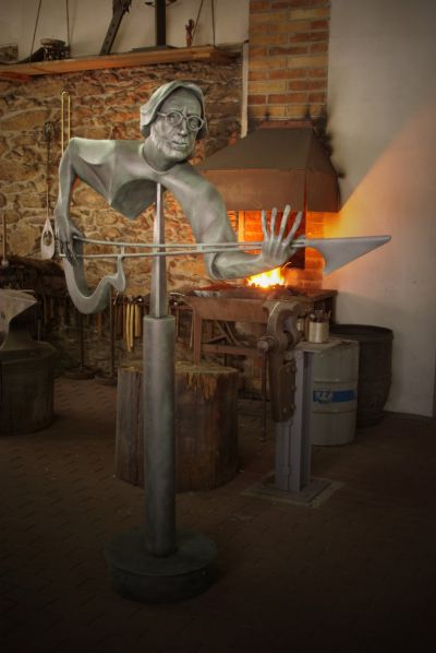 Bluesman - kinetic forged sculpture (2016). Material: metal, granit - height 1.8 m.